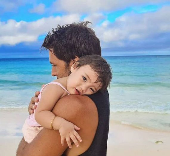 Nico Bolzico and Solenn Heusaff teaches Tili to love water